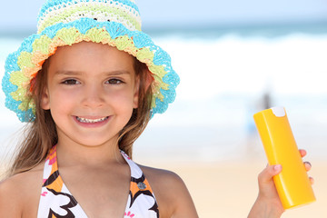 Girl holding sun-cream