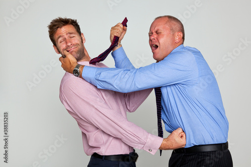 Two businessmen fighting