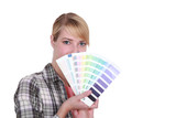 Woman choosing new color for house