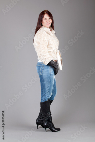 young woman over grey background. Portrait of a beautiful woman,