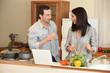 happy duo in kitchen