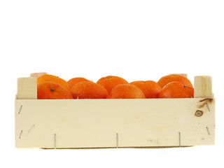fresh tangerines in a wooden crate box