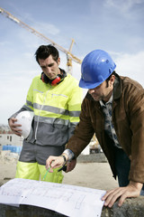 Foreman and colleague examining plans