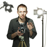 Photographer with retro camera in studio