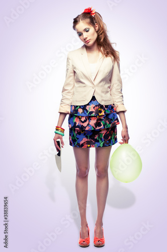 Girl with knife and balloon
