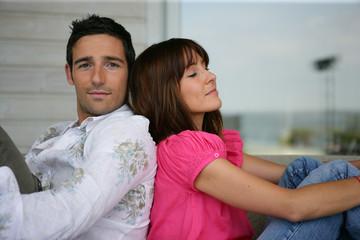 Couple sat on porch