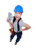 female electrician holding bunch of dollars