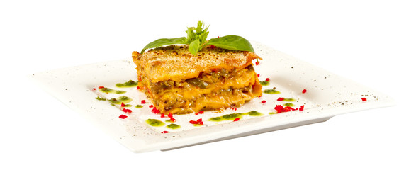 Closeup of lasagna and basil fork
