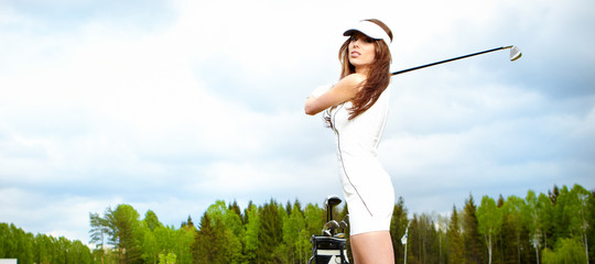 Portrait of an elegant woman playing golf on a green woman