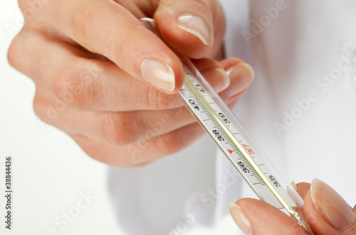 Hands holding thermometer