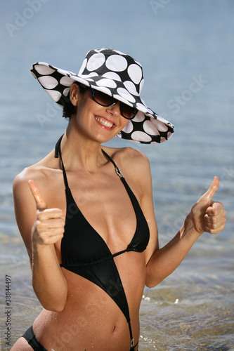 Trendy woman at the beach
