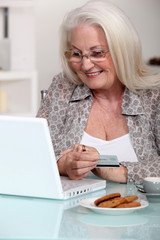 senior lady shopping on the internet