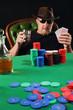 Serious poker player wearing sunglasses