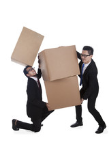 Businessmen carrying boxes