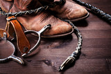 Cowboy boots,whip and spurs on wood
