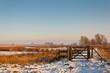Wooden fence in a snowy Dutch landscape