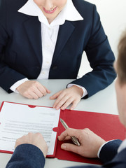 Young woman reads the characteristics in a job interview