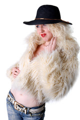 Curly blonde in a black hat and white fluffy fur coat