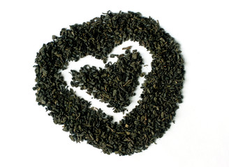 Green tea in heart and round shape isolated