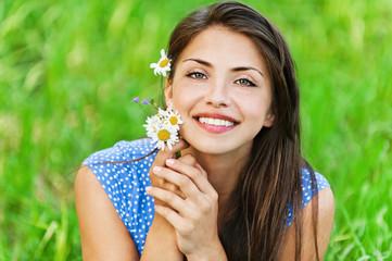 portrait pretty young woman bouquet wildflowers