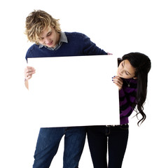 young couple holding a blank sign