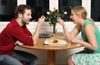 A young couple eating dinner