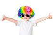 portrait of a boy in colored wig and glasses