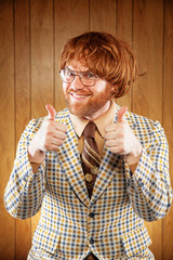 Happy Nerdy 60s Game Show Host Giving 2 Thumbs Up