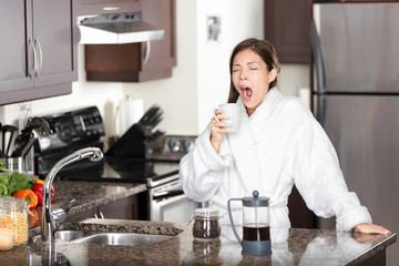 Yawning coffee woman in morning