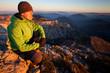 Young man enjoying autumn mountain sunset