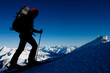 Silhouette of ski mountaineer in winter Alps