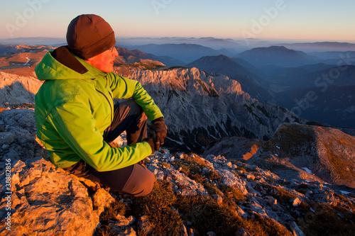 Young man enjoying autumn mountain view