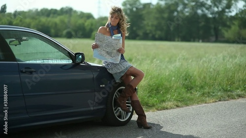 Young beautiful woman looking at a map; Full HD Photo JPEG