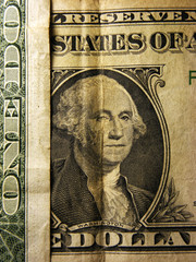 George Washington on a one dollar bil. Selective focus