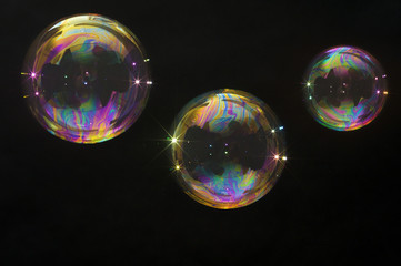 3 party soap bubbles isolated on black. Extremely detailed.
