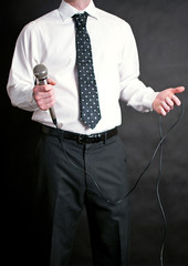 Man in shirt and tie with microphone