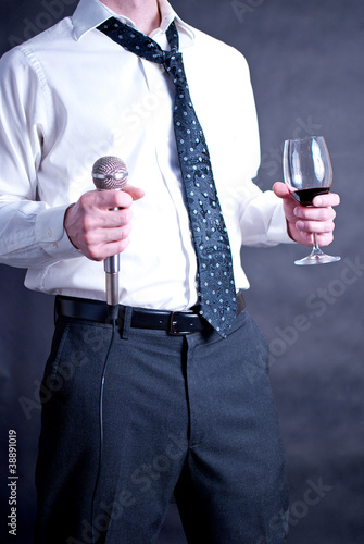 Man with drink and microphone