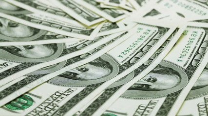 Rotating 100 US dollars bank notes business background