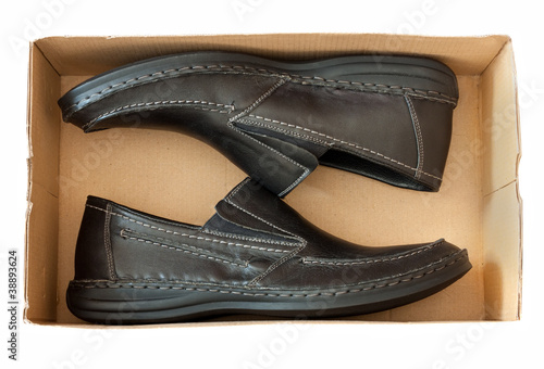 men's shoes in a box over white background