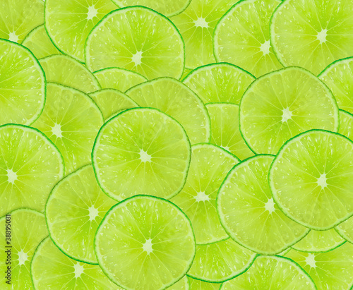 Zdjęcia na płótnie, fototapety na wymiar, obrazy na ścianę : Lime slices background with a space for text