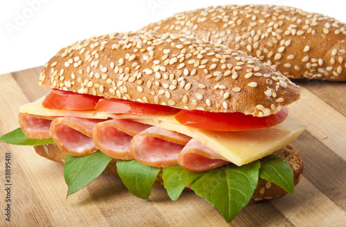 Big appetizing fast food baguette sandwich - 38895481