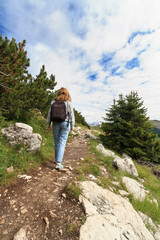 Escursionista - hiker in alpine pathway