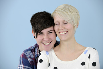 portrait of a lesbian couple on blue background