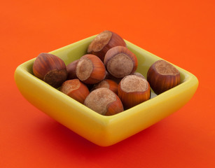 Group of hazelnuts in a bowl.