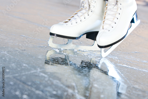 Fotobehang Wintersporten Tilted natural version, ice skates with reflection