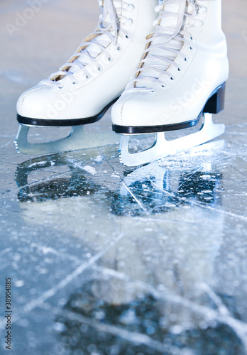 Portrait version, woman ice skates with reflection