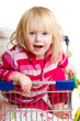 Adorable baby with toys and gifts in shop cart