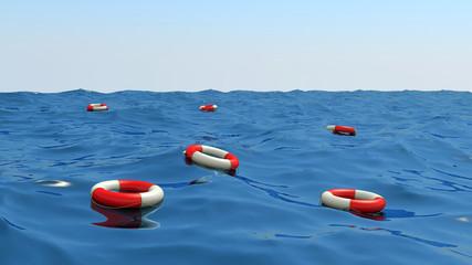 lifebuoys floating on waves