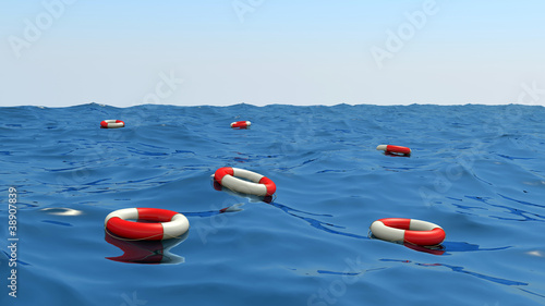 lifebuoys floating on waves