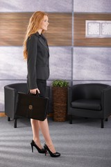 Smiling businesswoman arriving to office